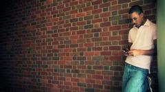 Black Male University Student Alone Texting On Phone Arkistovideo