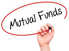 Man Hand writing Mutual Funds  with black marker on visual screen - stock photo