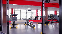 Back view of fit female athlete with hot butt doing fitness exercises in the gym Stock Footage