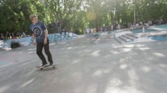 Stock Video Footage of Skater make extreme slide on fence in skate park. Slow motion. Contest