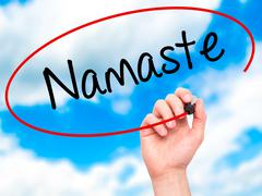 Man Hand writing Namaste with black marker on visual screen Stock Photos