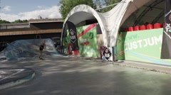 Skater make extreme back slide on fence in skate park. Slow motion. Contest - stock footage