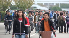 China college education, students walk cycle on Shanghai university campus Stock Footage