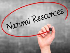Man Hand writing Natural Resources with black marker on visual screen Stock Photos