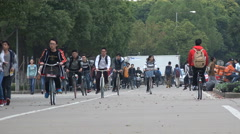 College students cycle over campus of Shanghai university in China - stock footage