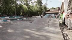 Skater make extreme full flip in skate park. Challenge. Camera moves Stock Footage