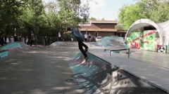 Skater try to make extreme jump in skate park, but failed. Camera moves - stock footage
