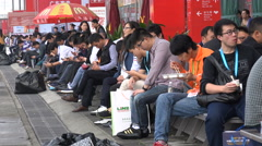 Business people eat lunch at a food and beverage exhibition in Shanghai, China - stock footage