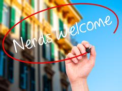 Man Hand writing Nerds Welcome with black marker on visual screen - stock photo