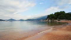 Sunny empty beach with pebble in Montenegro, Budva Stock Footage