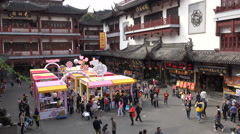 Candy stores in renovated traditional style shopping plaza Shanghai Stock Footage