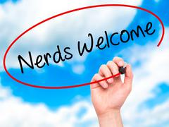 Man Hand writing Nerds Welcome with black marker on visual screen Stock Photos