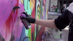 MOSCOW, RUSSIA - JUNE 6, 2015: Graffiti artist paint spraying the wall. Slow Stock Footage
