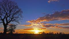 Evening sunset over english countryside winter landscape timelapse Stock Footage