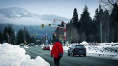 Woman Walks By Busy Road In Mountains - stock footage
