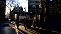 London. Charing Cross Road against the sun. Timelapse Stock Footage