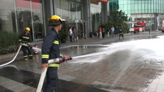 Firefighters at work during a fire drill for office employees in Shanghai, China Stock Footage