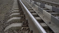Close up railway track in the field. Slowly - stock footage