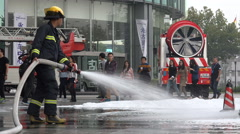Asian firefighter at work during a fire drill in Shanghai, China Stock Footage