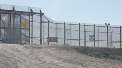 Border Patrol SUV Sits Guarding the American and Mexican Border Stock Footage