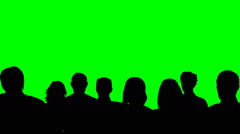 Crowd silhouette watching something on a green screen Stock Footage