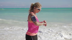 Sportswoman running by sea slow motion Stock Footage