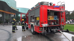 Chinese fire truck, firefighters, vehicle, emergency response, firemen, China Stock Footage