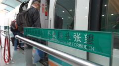Entrance to the Maglev train towards Shanghai Pudong International Airport Stock Footage