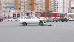 Side view of damaged car, stand on lively road intersection, front bumper fall Stock Footage