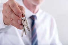 Real estate agent giving keys Stock Photos