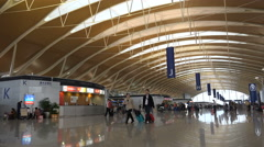 Modern departures hall at Pudong International Airport Shanghai, China Stock Footage