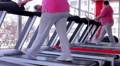 Tired overweight woman sweating on treadmill after intensive workout in the gym HD Footage