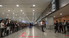 Passengers enter the arrival hall at Pudong Airport, Shanghai, China Stock Footage