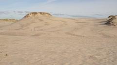 Little girl on the white sand dunes of Leba Stock Footage