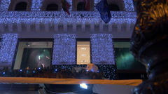 Tilt view of a building decorated with Christmas lights on Christmas in Budapest Stock Footage