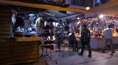 Outdoor restaurant and a street stall with hats at Christmas in Budapest Stock Footage