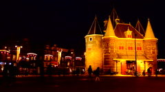 Medieval De Waag building in Amsterdam, Netherlands by night Stock Footage