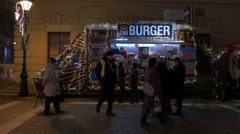 A food truck decorated with Christmas lights, on a street in Budapest - stock footage