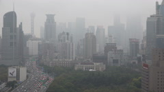 Misty Shanghai skyline, rainy weather, cityscape, urban China Stock Footage