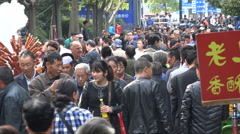 Popular snack stalls serve food to pedestrians at weekend market Shanghai China - stock footage