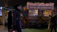 Walking next to a food stall with potato chips at a Christmas market in Budapest Stock Footage