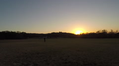 TIME LAPSE OF SUN SETTING AT DOG PARK Stock Footage
