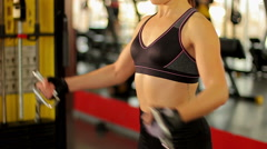 Stock Video Footage of Strong lady working hard in the gym to achieve success at sports competition