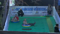 People at a tubing spot on Christmas in Budapest Stock Footage