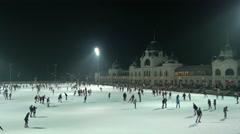 Ice skating on Christmas, near Városliget Café & Restaurant in Budapest Stock Footage