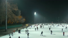 Pan view of people ice skating on Christmas in the City Park of Budapest Stock Footage