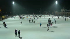 Many people ice skating on Christmas in the City Park of Budapest at night Stock Footage