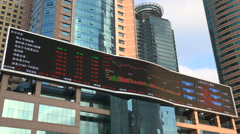 China electronic ticker board, stock exchange, Shanghai business district Stock Footage