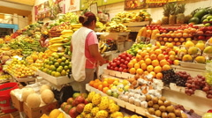 A Vendor Retrieves Bananas in a Farmers' Market in Quito, Ecuador Stock Footage