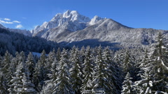 Aerial - Beautiful wintry scenery with mountains and land in snow Stock Footage